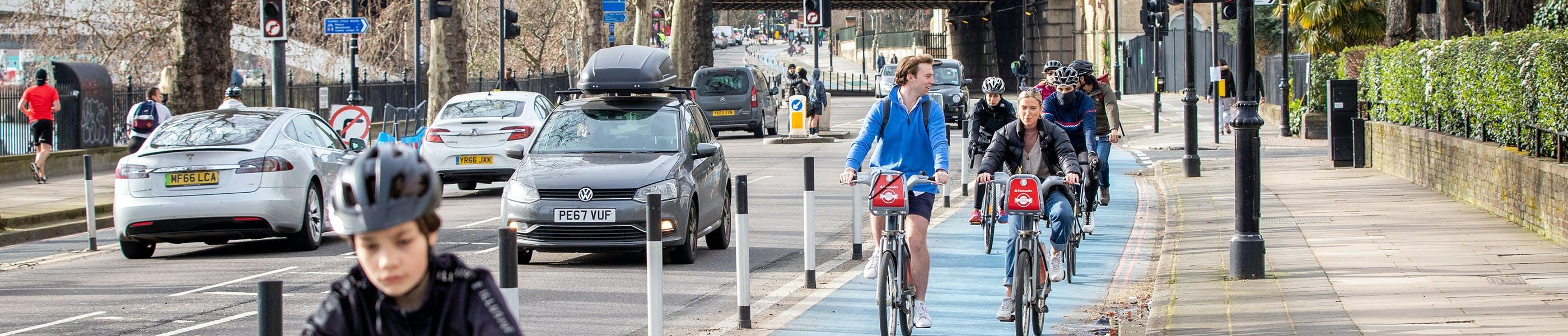 People cycling along CS8 cycleway