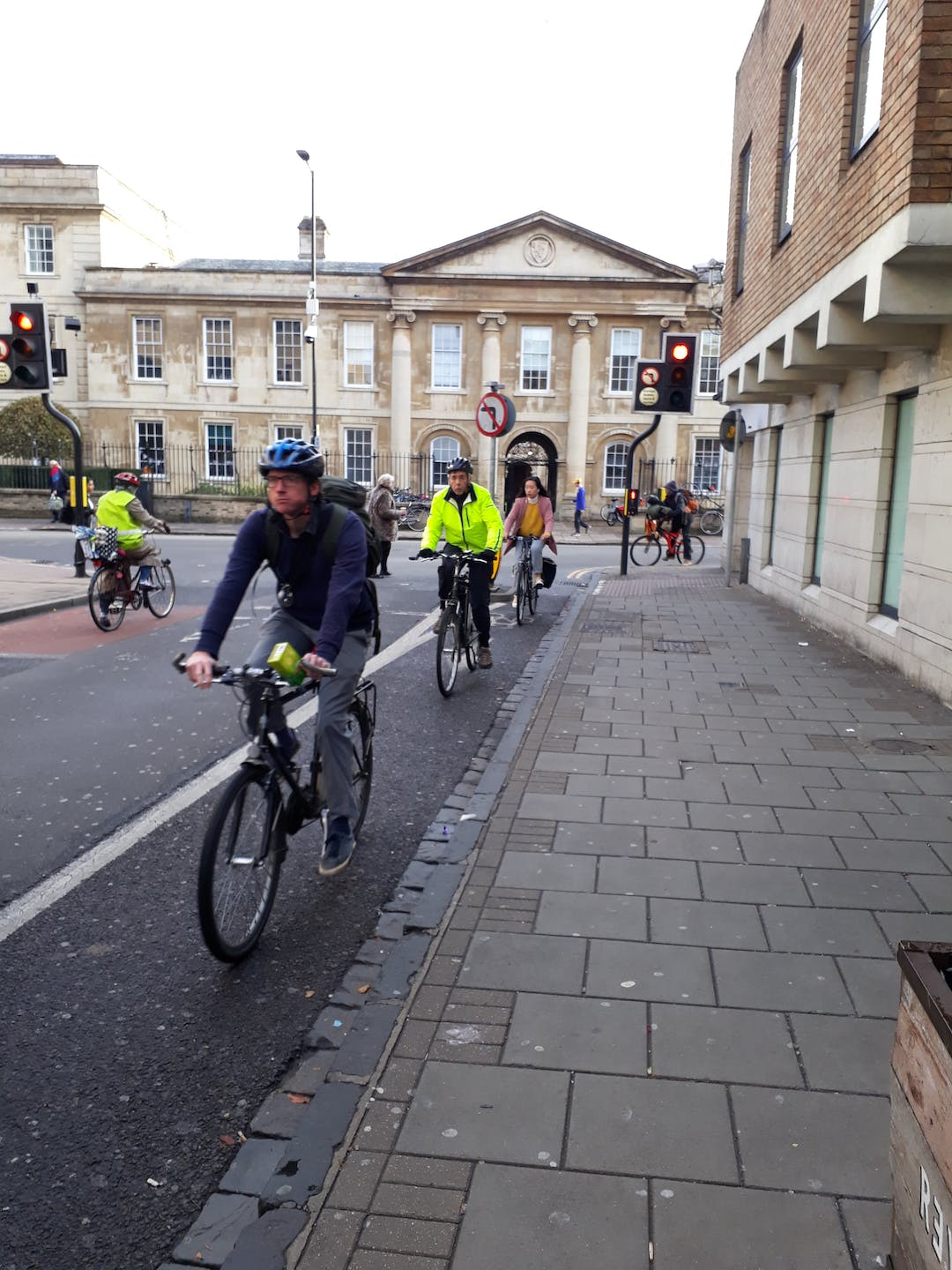 Cyclists in Cambridge turning on to Downing Street