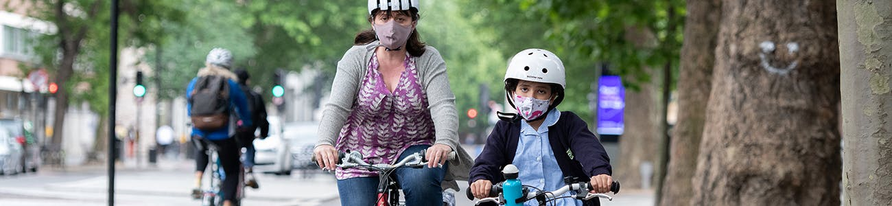 Image of a woman and child cycling