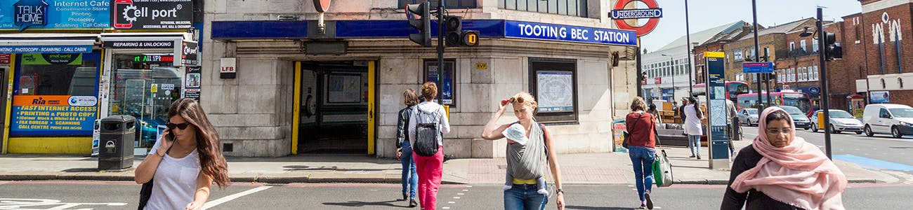 People crossing street at Tooting Bec station