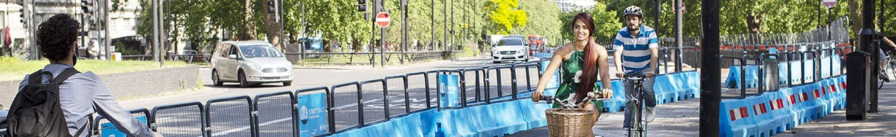Two people cycling on Park Lane