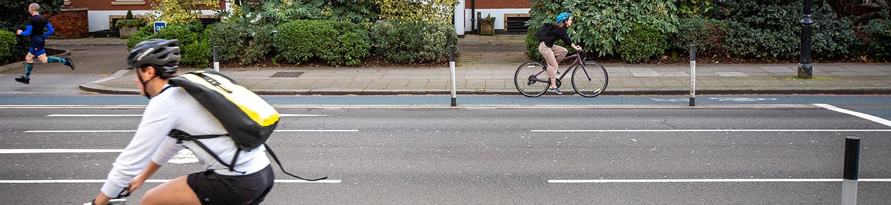 Two people cycling on a temporary cycle lane