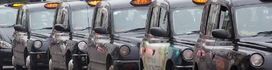 Several taxis waiting at a rank