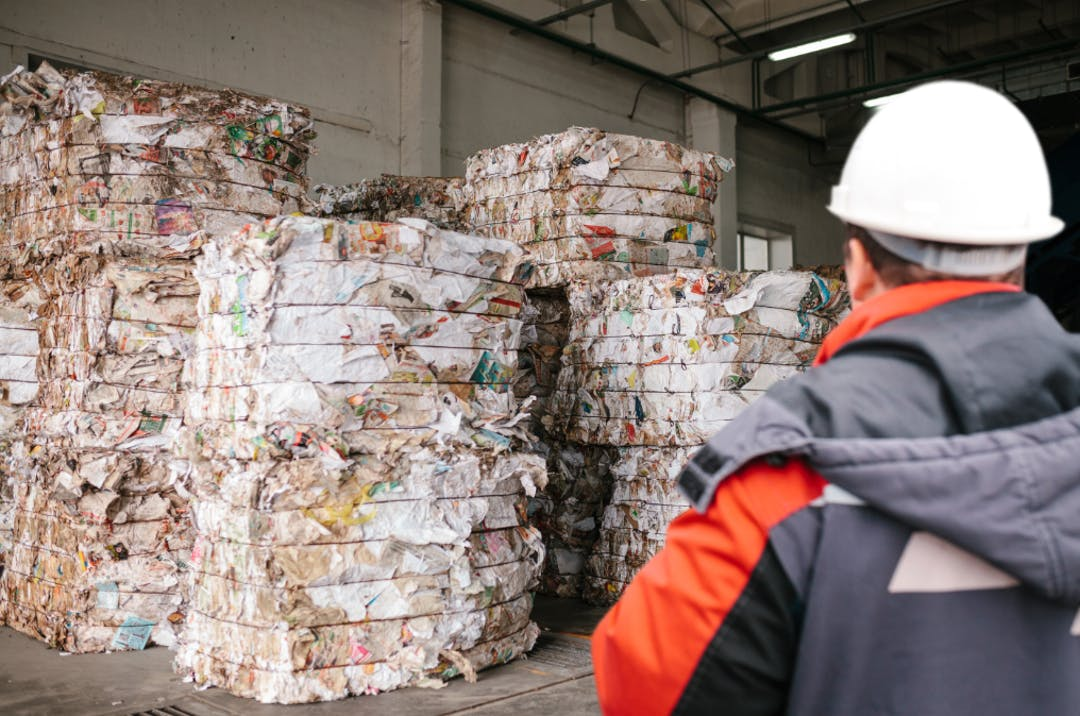 Man looking at recycling waste