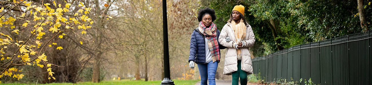 Two people walking in park
