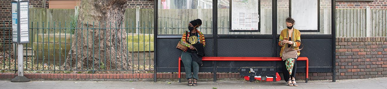 Image of people waiting at a bus stop