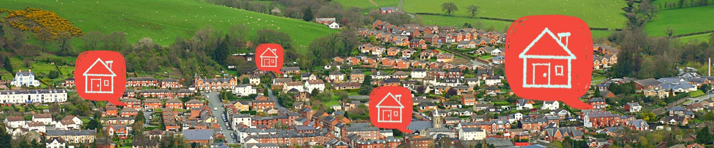 Photo of Newtown in Powys with four red speech bubbles with an icon of a house in each