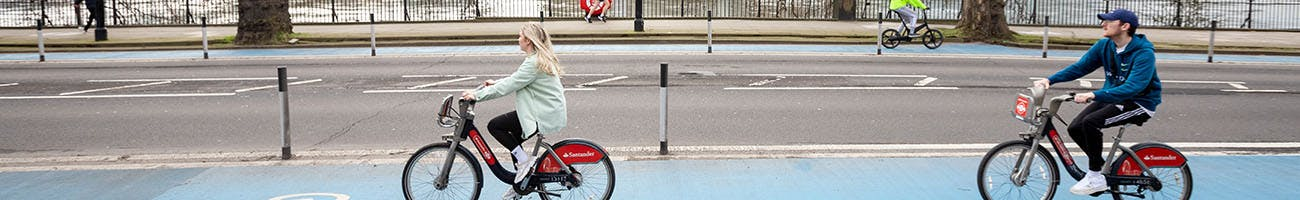Two people cycling on Santander Cycle Hire bikes
